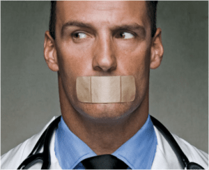 doctor with bandaid over mouth