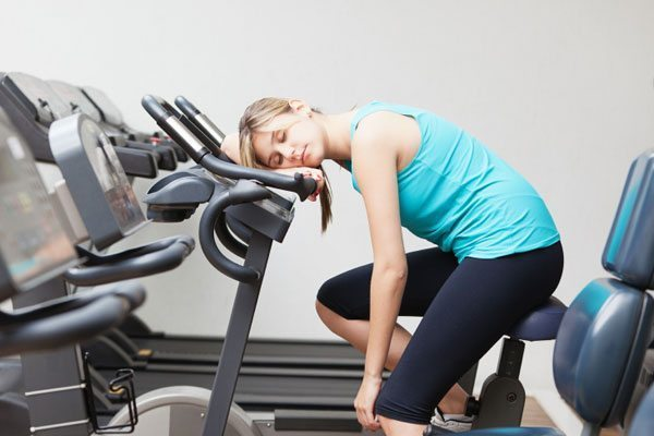 woman asleep while working out