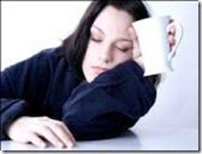 woman asleep with mug