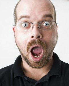 surprised man with glasses