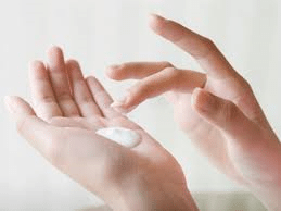 progesterone creams in hand