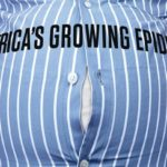 """Mans stomach that says """"America's growing epidemic"""" obesity"""